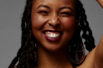 A photo of woman smiling at the camera.