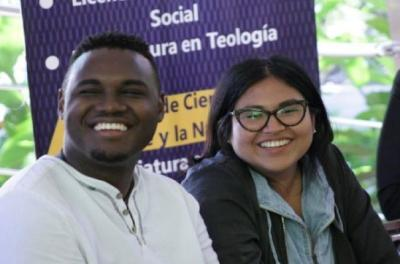 Image of two students smiling at the camera.