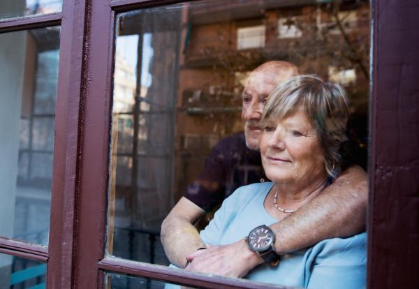 A couple looking out of a window.