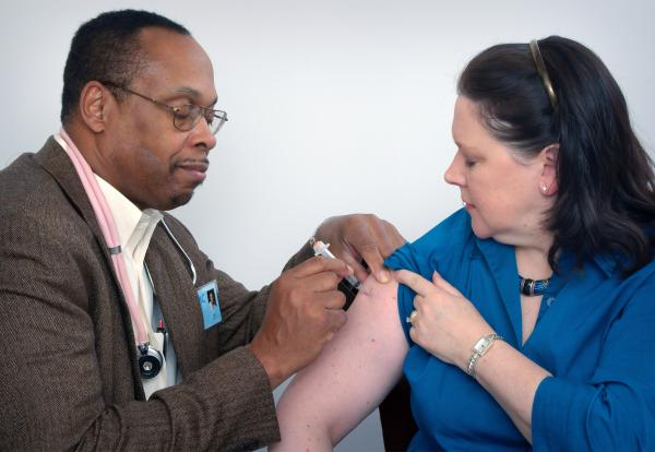 Doctor giving a patient a vaccination